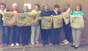 Students displaying their unfinished rugs after the course in Ancaster, Ontario